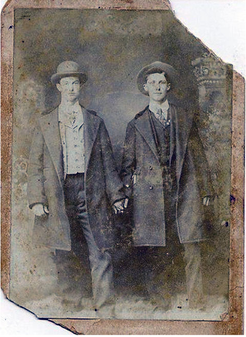 vintage gay, two men holding hands, late 19th century studio photograph