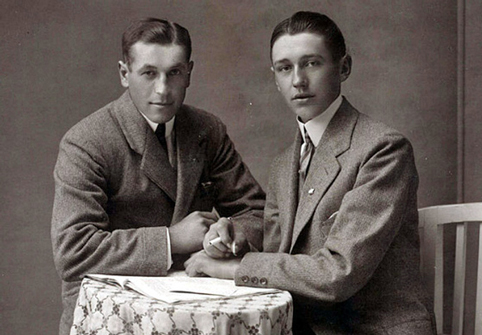Two men seated, vintage gay love