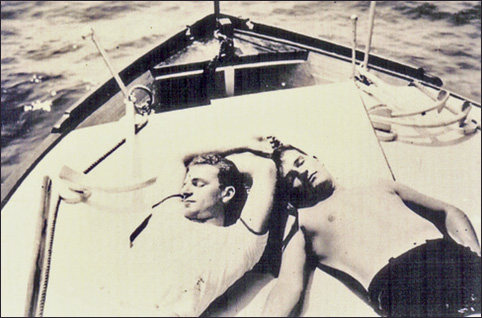 Two men lying on a boat, vintage gay