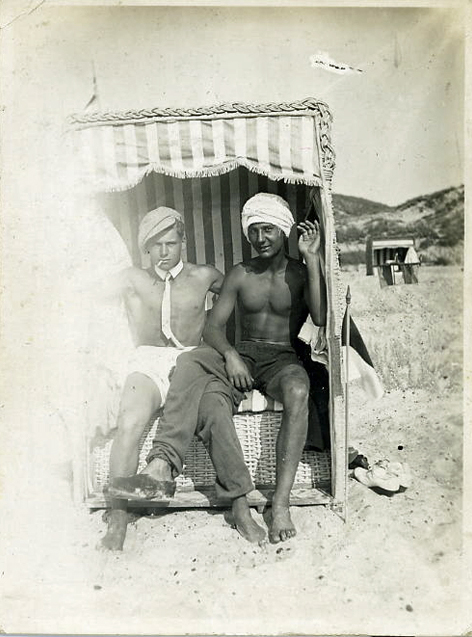 Two men sitting in a cabana, vintage gay photo